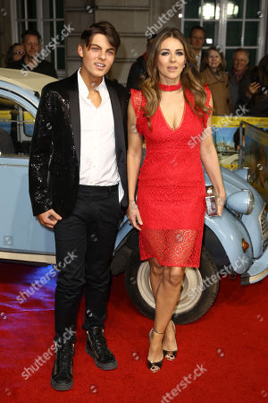Elizabeth Hurley and son Damien pose for photographers on the red carpet during the UK premiere for the film 'The Time of Their Lives' at a central London cinema