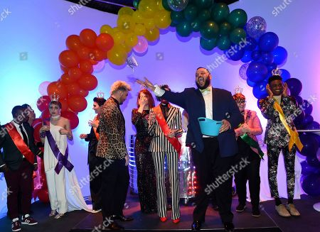 Daniel Franzese, third from right, tosses a crown at BuzzFeed's Inaugural Queer Prom at Siren Studios on in Los Angeles. The event honored every student's right to experience prom. BuzzFeed selected six high school students from across the country to join the festivities. Other guests included local LA area LGBT high school seniors, celebrities, performers, and advocates who will all be featured in a special BuzzFeed video series
