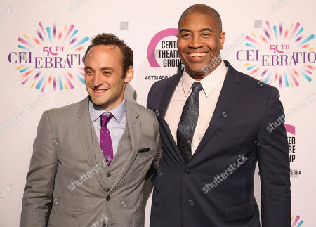 Stock Image of Charlie Hofheimer, left, and Paul Oakley Stovall arrive at the Center Theatre Group 50th Anniversary event, in Los Angeles