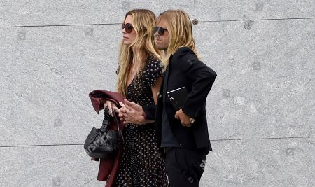 Stock Picture of Taylor Hawkins, of Foo Fighters, right, and Alison Hawkins attend a funeral for Chris Cornell at the Hollywood Forever Cemetery, in Los Angeles