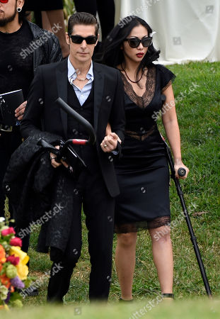 Perry Farrell, left, and Etty Lau Farrell attend a funeral for Chris Cornell at the Hollywood Forever Cemetery, in Los Angeles