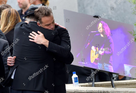Stock Picture of Matt Cameron, of Soundgarden, right, hugs a guest at a funeral for Chris Cornell, pictured right, at the Hollywood Forever Cemetery, in Los Angeles