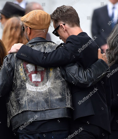 Tom Morello, left, and Matt Cameron, of Soundgarden, attend a funeral for Chris Cornell at the Hollywood Forever Cemetery, in Los Angeles