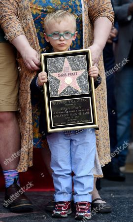 Jack Pratt, the son of actor Chris Pratt, holds a replica of Pratt's star on the Hollywood Walk of Fame during a ceremony, in Los Angeles