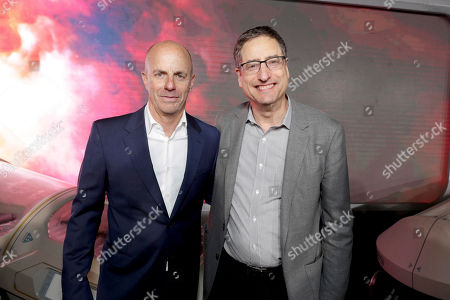 """Producer Neal H. Moritz and Tom Rothman, Chairman, Sony Pictures Motion Picture Group, seen at Columbia Pictures World Premiere of """"Passengers"""" at Regency Village Theatre, in Los Angeles"""