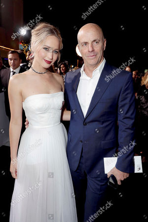 """Jennifer Lawrence and Producer Neal H. Moritz seen at Columbia Pictures World Premiere of """"Passengers"""" at Regency Village Theatre, in Los Angeles"""
