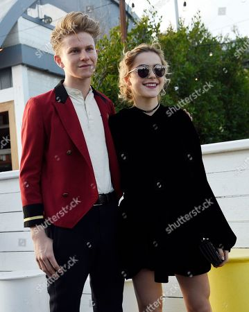 Chef Flynn McGarry, left, and actress Kiernan Shipka pose together at the Dior Cruise Welcome Dinner at the Dior Surf Club, in Los Angeles