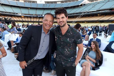 Dave Roberts, left, Los Angeles Dodgers Manager, and Taylor Lautner seen at the Los Angeles Dodgers Foundation Blue Diamond Gala 2017 at Dodgers Stadium, in Los Angeles