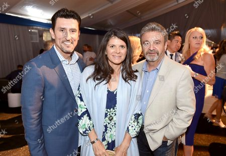 Nomar Garciaparra, from left, Mia Hamm and Ned Colletti are seen at the Los Angeles Dodgers Foundation Blue Diamond Gala 2017 at Dodgers Stadium, in Los Angeles