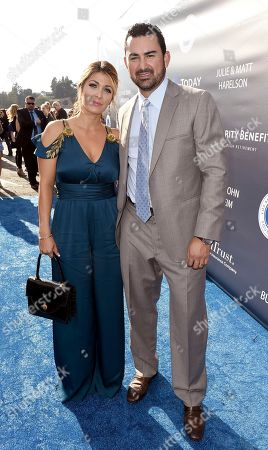 Betsy Gonzalez, left, and Adrian Gonzalez arrive at the Los Angeles Dodgers Foundation Blue Diamond Gala 2017 at Dodgers Stadium, in Los Angeles