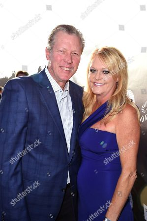 Orel Hershiser, left, and Dana Deaver arrive at the Los Angeles Dodgers Foundation Blue Diamond Gala 2017 at Dodgers Stadium, in Los Angeles