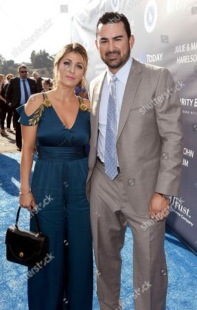 Stock Image of Betsy Gonzalez, left, and Adrian Gonzalez arrive at the Los Angeles Dodgers Foundation Blue Diamond Gala 2017 at Dodgers Stadium, in Los Angeles