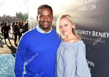 Alfonso Ribeiro, left, and Angela Unkrich arrive at the Los Angeles Dodgers Foundation Blue Diamond Gala 2017 at Dodgers Stadium, in Los Angeles