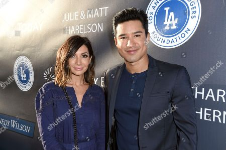 Courtney Laine Mazza, left, and Mario Lopez arrive at the Los Angeles Dodgers Foundation Blue Diamond Gala 2017 at Dodgers Stadium, in Los Angeles