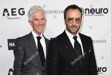 Richard Buckley and Tom Ford arrive at Elton John's 70th Birthday and 50-Year Songwriting Partnership with Bernie Taupin on in Los Angeles