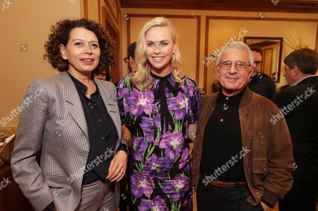 Donna Langley, Chairman of Universal Pictures, Charlize Theron and Ronald Meyer, Vice Chairman of NBCUniversal, seen at Focus Features: Celebrating 15 Years and a Bright Future at 2017 CinemaCon, in Las Vegas