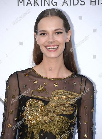 Model Mina Cvetkovic poses for photographers upon arrival at the amfAR charity gala during the Cannes 70th international film festival, Cap d'Antibes, southern France