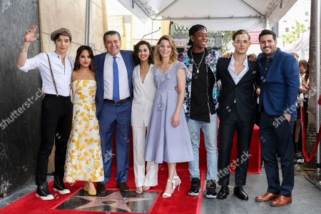 Ludi Lin, from left, Naomi Scott, Haim Saban, Becky G, Elizabeth Banks, RJ Cyler, Dacre Montgomery, and Dean Israelite pose for a Power Rangers cast photo at the Haim Saban Star on the Hollywood Walk of Fame ceremony, in Los Angeles