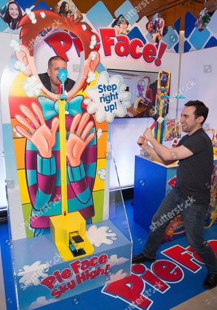 "Step right up to the PIE FACE SKY HIGH game! Inspired by the strong man carnival games, demonstrators in the Hasbro, Inc. showroom at American International Toy Fair plays a larger-than-life PIE FACE SKY HIGH game from Hasbro Gaming, which features a three-foot-tall face mask and ""pie slammer hammer"" for silly, competitive pie-in-the-face fun, on in New York"