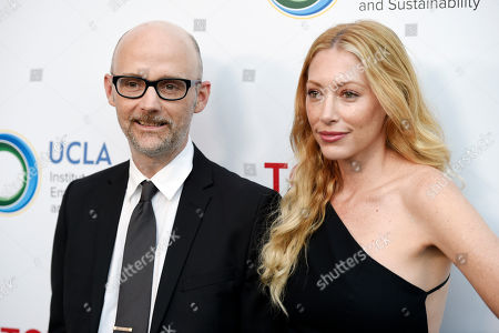 """Musician Moby and Julie Mintz arrive together at the UCLA Institute of the Environment and Sustainability's """"Innovators for a Healthy Planet"""" gala, in Beverly Hills, Calif"""