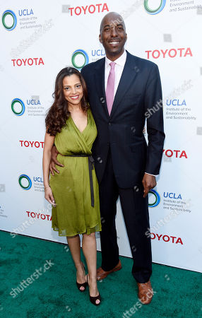 "Host John Salley and his wife Natasha pose together at the UCLA Institute of the Environment and Sustainability's ""Innovators for a Healthy Planet"" gala, in Beverly Hills, Calif"