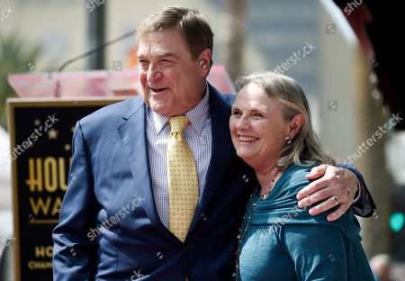 Actor John Goodman, left, poses with actress Tess Harper during a ceremony to award Goodman a star on the Hollywood Walk of Fame, in Los Angeles