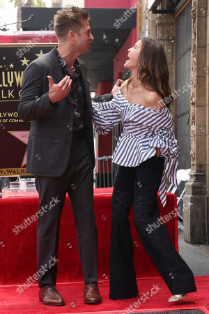 Scott Speedman, left, and Keri Russell joke at the Star on the Hollywood Walk of Fame ceremony, in Los Angeles