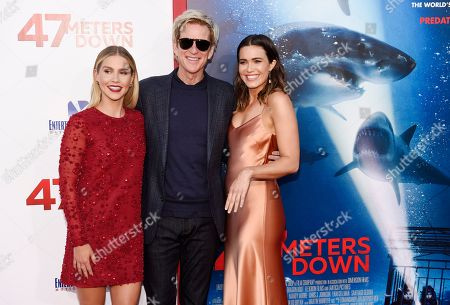 "Claire Holt, left, Matthew Modine, center, and Mandy Moore, cast members in ""47 Meters Down,"" pose together at the premiere of the film at the Regency Village Theatre, in Los Angeles"