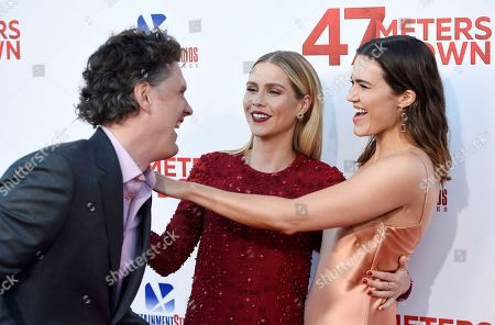 "Johannes Roberts, from left, director of ""47 Meters Down,"" greets cast members Claire Holt and Mandy Moore at the premiere of the film at the Regency Village Theatre, in Los Angeles"