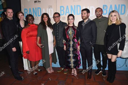 """Colin Hanks, from left, Brooklyn Decker, Angelique Cabral, Fred Armisen, Zoe Lister-Jones, Adam Pally, Jessie Williams and Majandra Delfino arrive at the Los Angeles premiere of """"Band Aid"""" at the Theater at the Ace Hotel on"""