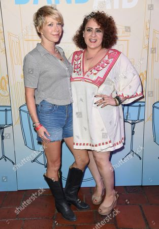 """Mary Elizabeth Ellis, left, and Artemis Pebdani arrive at the Los Angeles premiere of """"Band Aid"""" at the Theater at the Ace Hotel on"""