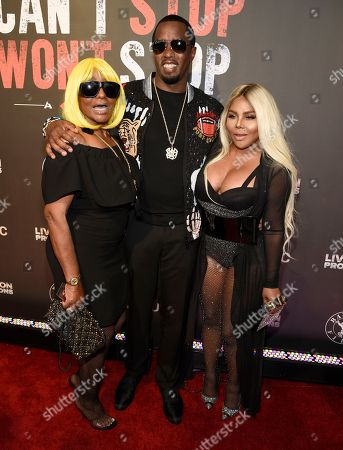 """Janice Combs, from left, Sean """"Diddy"""" Combs and Lil' Kim arrive at the Los Angeles premiere of """"Can't Stop, Won't Stop: A Bad Boy Story"""" at the Writers Guild Theater, in Beverly Hills, Calif"""