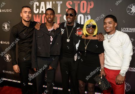 """Quincy Brown, from left, Christian Combs, Sean """"Diddy"""" Combs, Janice Combs and Justin Combs arrive at the Los Angeles premiere of """"Can't Stop, Won't Stop: A Bad Boy Story"""" at the Writers Guild Theater, in Beverly Hills, Calif"""