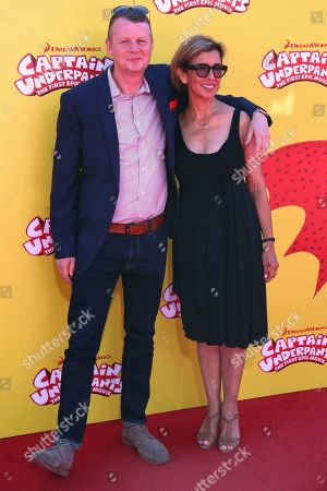 """Mark Swift, left, and Mireille Soria arrive at the LA Premiere of """"Captain Underpants: The First Epic Movie"""" at the Regency Village Theatre, in Los Angeles"""