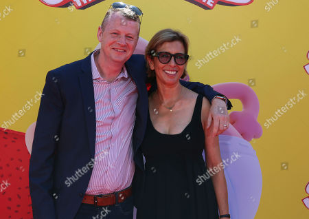 """Stock Picture of Mark Swift, left, and Mireille Soria arrive at the LA Premiere of """"Captain Underpants: The First Epic Movie"""" at the Regency Village Theatre, in Los Angeles"""