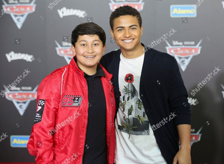 "Kamran Lucas, left, and Nathaniel Potvin arrive at the LA Premiere of ""Cars 3"", in Anaheim, Calif"