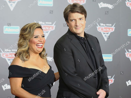 "Cristela Alonzo, left, and Nathan Fillion arrive at the LA Premiere of ""Cars 3"", in Anaheim, Calif"