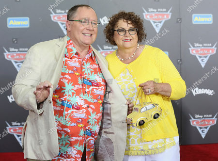 "John Lasseter, left, and Nancy Lasseter arrive at the LA Premiere of ""Cars 3"", in Anaheim, Calif"