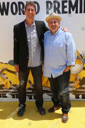 """Cinco Paul, left, and Ken Daurio arrive at the World Premiere of """"Despicable Me 3"""" at the Shrine Auditorium, in Los Angeles"""