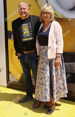 "Chris Meledandri, left, and Janet Healy arrive at the World Premiere of ""Despicable Me 3"" at the Shrine Auditorium, in Los Angeles"