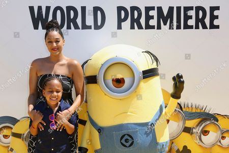 "Tia Mowry, back, and daughter Cree Taylor Hardrict arrive at the World Premiere of ""Despicable Me 3"" at the Shrine Auditorium, in Los Angeles"