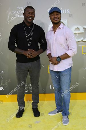 """Stock Picture of Edwin Hodge, left, and Arjay Smith arrive at the LA Premiere of """"Genius"""" at the Fox Theatre at Westwood Village, in Los Angeles"""