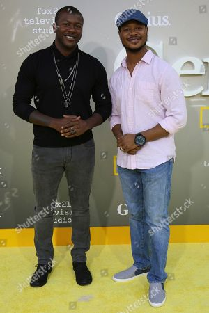 """Edwin Hodge, left, and Arjay Smith arrive at the LA Premiere of """"Genius"""" at the Fox Theatre at Westwood Village, in Los Angeles"""