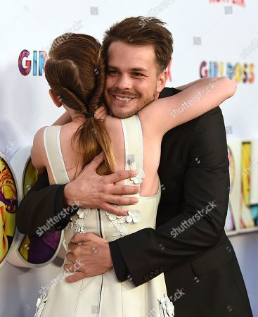 "Britt Robertson, left, hugs Johnny Simmons as they arrive at the Los Angeles premiere of ""Girlboss"" at ArcLight Hollywood on"