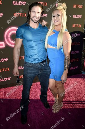 """Stock Photo of John Hennigan and Kira Forster attend the LA Premiere of """"Glow"""" at ArcLight Hollywood, in Los Angeles"""