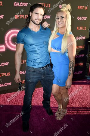 """Stock Picture of John Hennigan and Kira Forster attend the LA Premiere of """"Glow"""" at ArcLight Hollywood, in Los Angeles"""