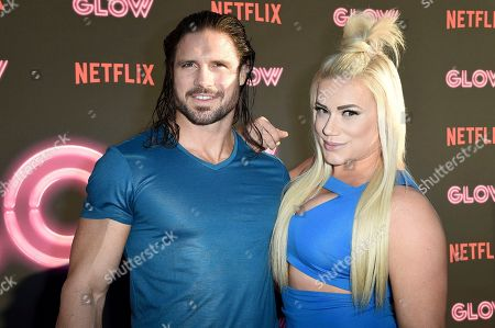 """John Hennigan and Kira Forster attend the LA Premiere of """"Glow"""" at ArcLight Hollywood, in Los Angeles"""