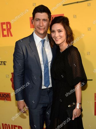 """Ken Marino, left, and Erica Oyama arrive at the Los Angeles premiere of """"How to Be a Latin Lover"""" at the ArcLight Hollywood on"""