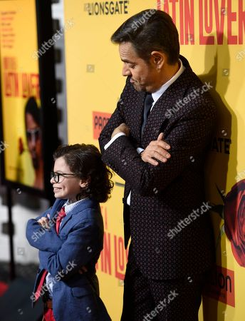 """Raphael Alejandro, left, and Eugenio Derbez arrive at the Los Angeles premiere of """"How to Be a Latin Lover"""" at the ArcLight Hollywood on"""