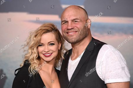 """Randy Couture, right, and Mindy Robinson arrive at the Los Angeles premiere of """"Kong: Skull Island"""" at the Dolby Theatre on"""